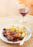 Pork provencal with baked potatoes Royalty Free Stock Photo