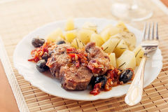 Pork provencal with baked potatoes Royalty Free Stock Photography