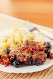 Pork provencal with baked potatoes Royalty Free Stock Image