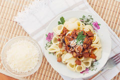 Pork Ragu with Pipe Pasta and Parmesan Royalty Free Stock Image