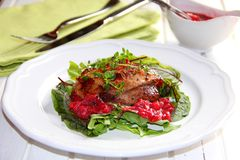 Pork with raspberry sauce. Baked pork loin with raspberry-ginger sauce stock photo