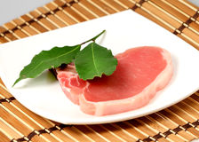 Pork raw meat and bay leaf Royalty Free Stock Photos