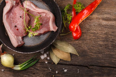 Pork raw meat. In a tray on a old wooden table Royalty Free Stock Images