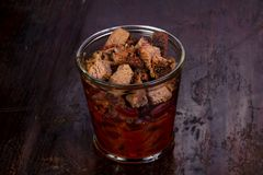 Pork with beans. Pork with red beans in the glass royalty free stock photography
