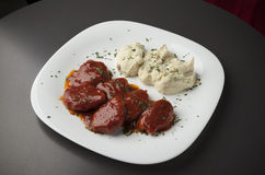 Pork in red sauce with mashed potatoes Stock Image