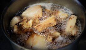 Pork reduced to hot fat oil royalty free stock photography