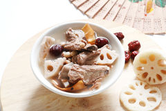 Pork rib soup. Traditional chinese traditional pork rib soup with lotus, ground peanut,dried squid and red dates royalty free stock image