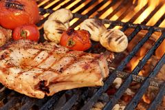 Pork Rib Steak, Tomato And Mushrooms On Hot BBQ Grill Royalty Free Stock Photos