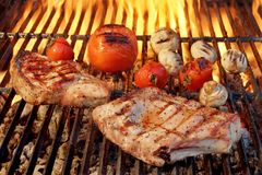 Pork Rib Steak, Tomato And Mushrooms On Hot BBQ Grill Stock Photography