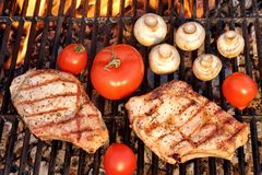Pork Rib Steak, Tomato And Mushrooms On Hot BBQ Grill Royalty Free Stock Images
