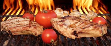Pork Rib Steaks, Tomato And Mushrooms On Hot BBQ Grill Royalty Free Stock Images