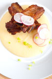 Pork ribbs on polenta corn cream bed Royalty Free Stock Images