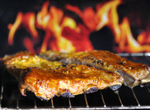 Pork ribs. On a grill stock photo