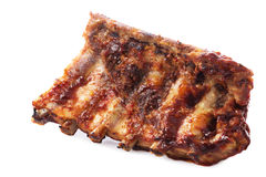 Pork ribs. Closeup of barbecued pork ribs royalty free stock image