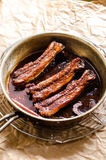 Pork ribs. Cooked in red wine sauce stock images