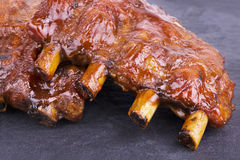 Pork ribs. Back on slate plate. Close up stock images