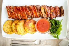 Pork ribs and barbecue sauce as main dish Stock Photos