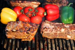 Pork Ribs, brisket, belly roasted in BBQ with vegetables Royalty Free Stock Photography