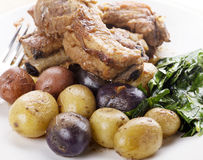 Pork Ribs with Fingerling Potatoes Stock Photos