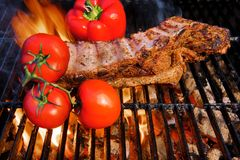 Pork Ribs in a flame in a  BBQ  Grill Stock Photography