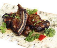 Pork ribs with mushrooms and herbs Royalty Free Stock Photos
