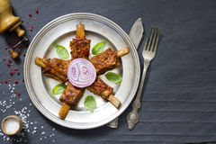 Pork ribs on old plate Royalty Free Stock Image