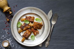 Pork ribs on old plate Stock Photos