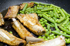 Pork ribs with peas and green beans Royalty Free Stock Photo