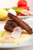 Pork ribs on polenta corn cream bed Royalty Free Stock Photography