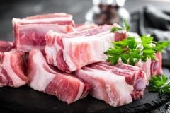 Pork ribs, raw meat. With bones Stock Photos