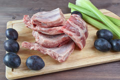 Pork ribs raw with plums and celery Stock Images