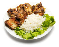 Pork ribs and rice decorated with salad. Over white background Royalty Free Stock Photos