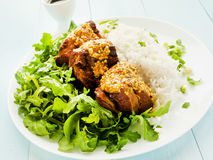 Pork ribs with rice and rucola Stock Photography