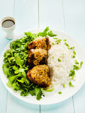 Pork ribs with rice and rucola Royalty Free Stock Images