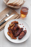 Pork ribs with roasted apples and bread Royalty Free Stock Photography