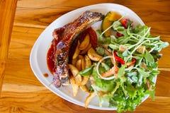 Pork ribs with salad Stock Image