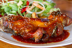 Pork ribs with salad Royalty Free Stock Photography