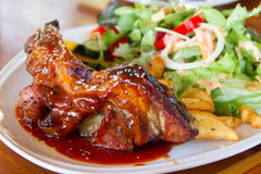 Pork ribs with salad Stock Photos