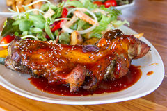 Pork ribs with salad Royalty Free Stock Photos