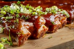 Pork ribs with sauce laid out on a wooden board-2. stock photography