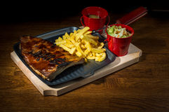 Pork Ribs. Served with chips and fresh salad stock photography