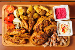 Pork ribs and steaks board Stock Images