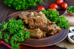 Pork ribs steamed with carrots, parsley decorated Stock Photo
