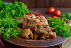 Pork ribs steamed with carrots, parsley decorated Stock Images