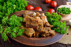 Pork ribs steamed with carrots, parsley decorated Royalty Free Stock Images