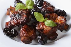 Pork ribs stewed with prunes and basil close-up. Stock Image