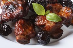 Pork ribs stewed with prunes and basil Horizontal close-up. Stock Photo