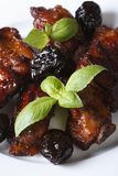 Pork ribs stewed with prunes and basil. vertical close-up. Stock Images