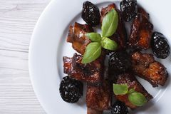 Pork ribs stewed with prunes closeup. horizontal top view Royalty Free Stock Images