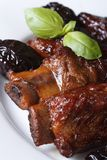 Pork ribs stewed with prunes macro vertical Stock Photography